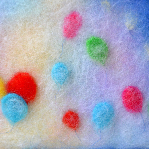 """Fragment of the wool painting """"Colorful Dreams"""" balloons in the air"""