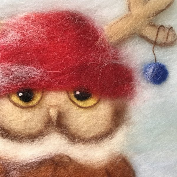"""Fragment of the wool painting """"Boy Owl Dressed for Christmas"""""""