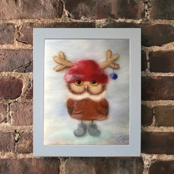 """Wool Painting """"Boy Owl Dressed for Christmas"""" by Oksana Ball in white frame"""