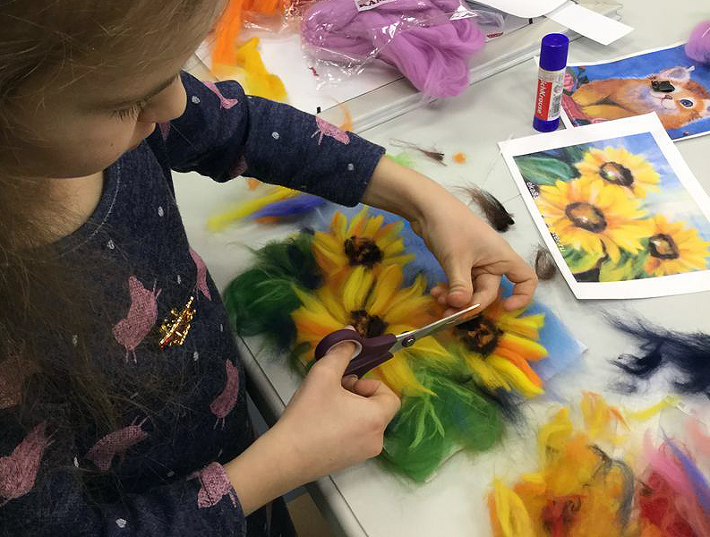 What does painting with wool give for children?